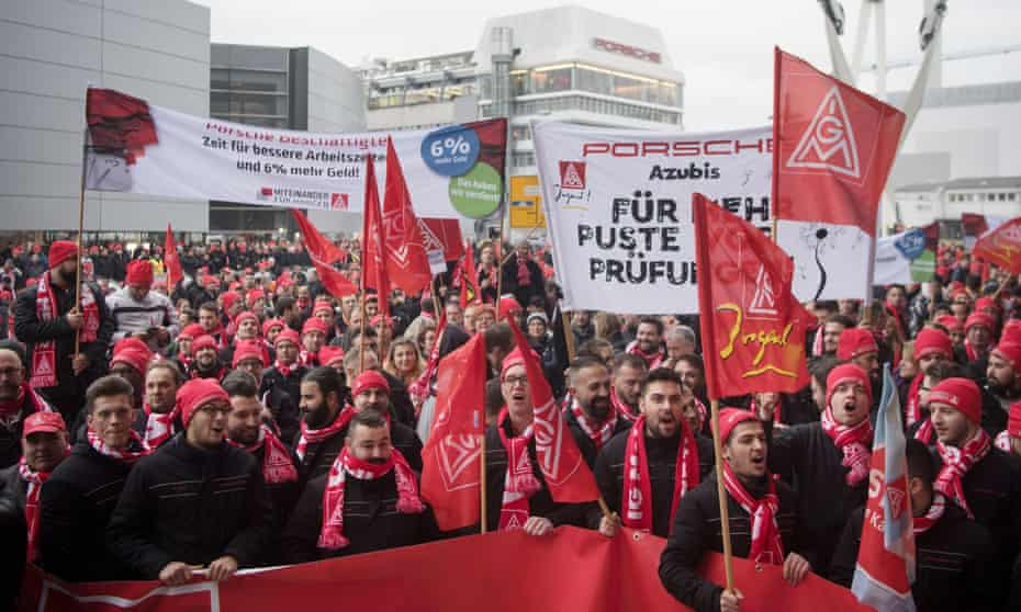 Employees of the Porsche AG company demonstrate on Monday in front of their plant in Stuttgart.