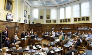 Councillors from Northamptonshire county council hold an extraordinary meeting in August 2018.