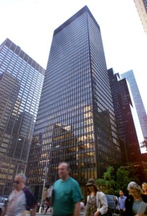 Pedestrians cross New York's Park Avenue in front of the landmark Seagram Building.