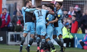 Stevenage players celebrate scoring at Lincoln in February. The club just missed out on the League Two play-offs last season
