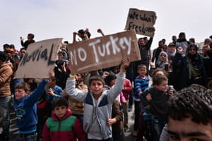 People chant 'No Turkey' at the port of Chios