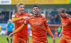 James Justin celebrates scoring for Luton against Scunthorpe at Kenilworth Road in League One earlier this season.