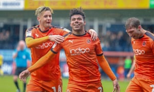 James Justin, centre, celebrates after scoring for Luton against Scunthorpe.