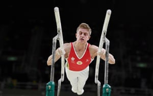 Ivan Stretovich of Russia competes on the parallel bars.