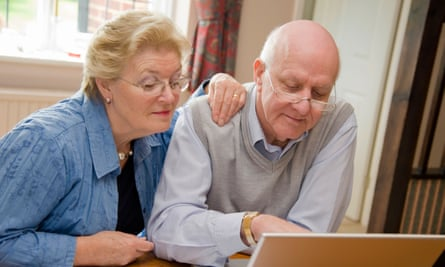 Mature senior couple using the internet on a laptop online