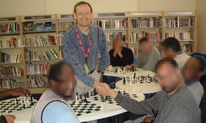 Carl Portman taking a chess session in HMP Wandsworth on 11 September 2014
