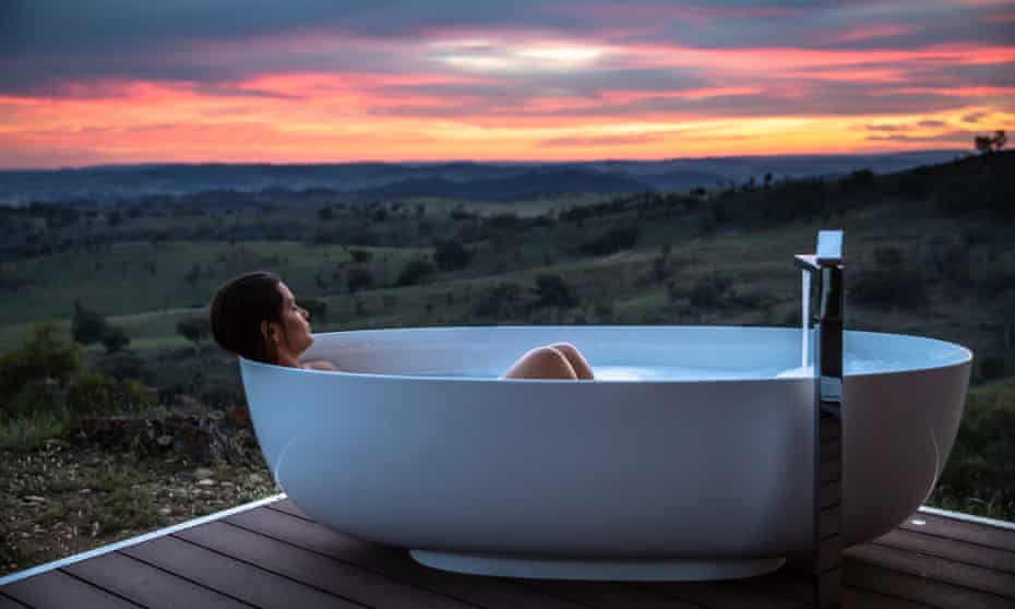 A woman in an outdoor bathtub at Sierra Escape
