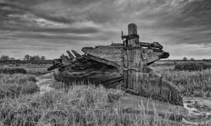The derelict remains of a sailing barge in Medway estuary marshes, Kent.