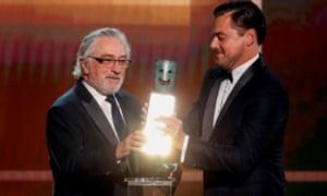 Robert De Niro is awarded the lifetime achievement award by Leonardo DiCaprio.