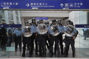 Riot police stand guard at an entrance of the airport, September 1, 2019.
