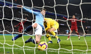 John Stones clears the ball off the line to prevent a farcical own goal giving Liverpool the lead.