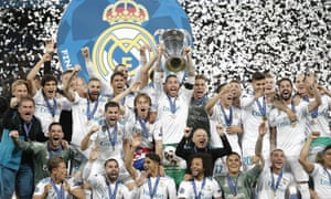 Sergio Ramos holds the Champions League trophy aloft after Real Madrid's win.