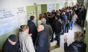 Voters queue at a polling station in Rome.
