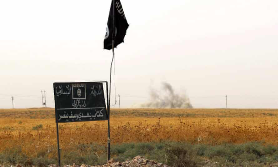 An Isis flag flies in Iraq.