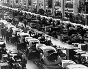 VW beetles are assembled in lines at the Volkwagen auto works plant in 1954.