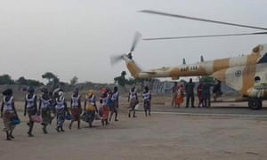 Some of the women being led to safety aboard a Nigerian army helicopter in 2017.
