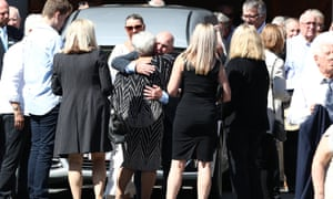 Rugby league legend Allan Langer consoles Tommy Raudonikis's wife Trish Brown