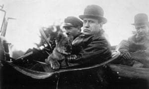 Mussolini goes for a drive with his pet lion in 1924