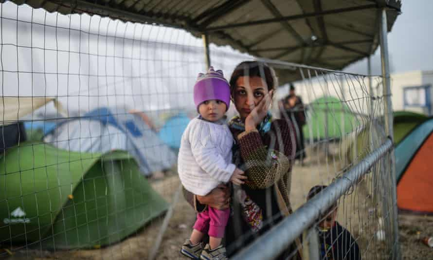 A refugee with her children on 1 April in a makeshift camp at the Greek-Macedonian border.