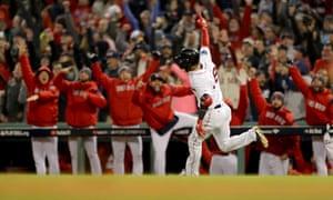 The Red Sox dugout reacts as Eduardo Nunez celebrates his three-run home run