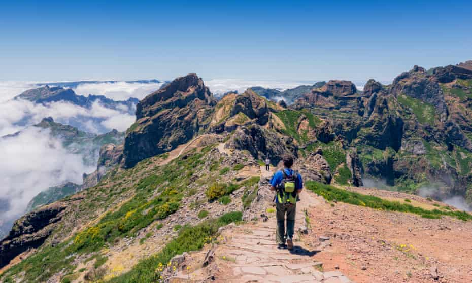 A hiker on the Vereda do Areeiro trail, which gives views of Pico Ruivo, the highest peak on Madeira