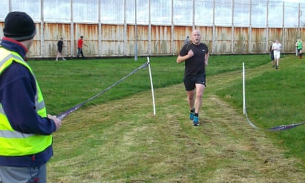 A member of Haverigg prison's staff finishes the Black Combe parkrun.