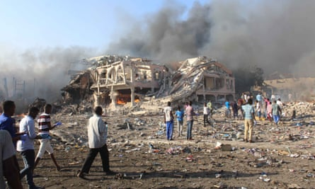 Citizens of Mogadishu survey the aftermath of a bombing by the Islamist group al-Shabaab on 14 October 2017. The 92 Somalis in the class action say they fear death and persecution at the hands of al-Shabaab.