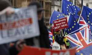 Pro and anti Brexit demonstrators wave their placards and flags outside the Houses of Parliament in London on Tuesday.