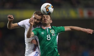 The Republic of Ireland's Kevin Doyle clashes with Iceland's Sverrir Ingi Ingason during a friendly in March 2017