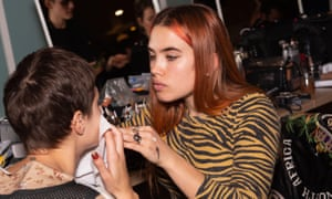 'I feel so honoured to be alive in the time of the Kardashians': Isamaya Ffrench puts the finishing touches on a model at a Vivienne Westwood show.