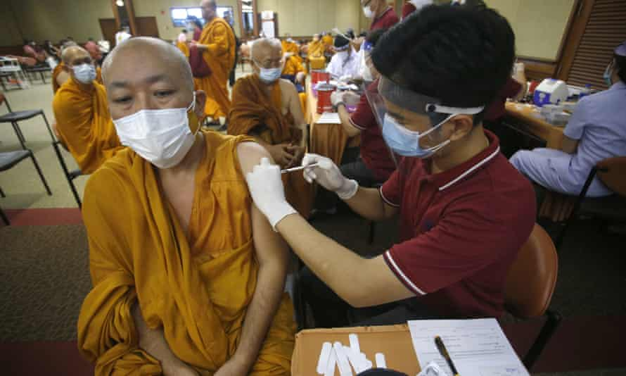 A health worker administers a Covid-19 vaccine to Buddhist monk at a hospital in Bangkok.
