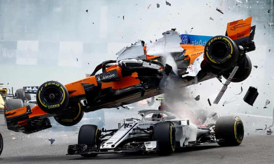 McLaren's Fernando Alonso and Sauber's Charles Leclerc crash at the first corner of the Belgian Grand Prix, later won by Ferrari's Sebastian Vettel with Lewis Hamilton finishing second.