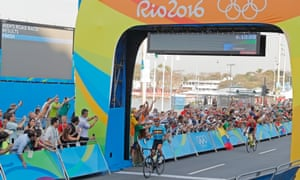 The crowds cheer as Belgium's Greg Van Avermaet celebrates after beating Jakob Fuglsang to gold in the men's road race at Fort Copacabana.