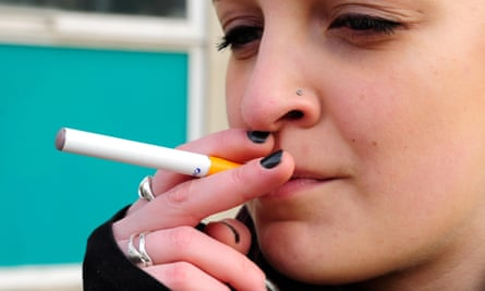 Young woman with e-cigarette