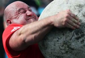 Visas Blekaitis lifts a rock