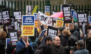 Protestors hold placards as they block the entrance to Woolwich Crown Court
