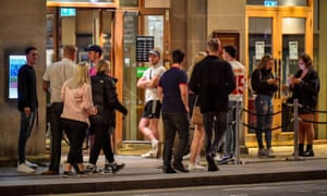 Young people queue to get into a pub in Cardiff city centre on Thursday night.