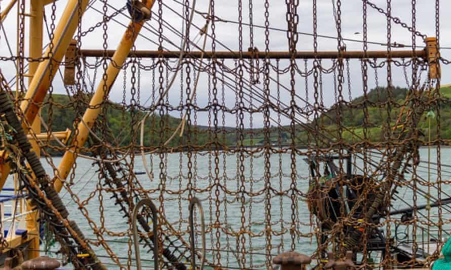 Beam trawler chains raised on booms