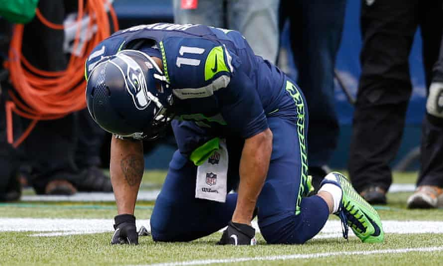 Seattle Seahawks wide receiver Percy Harvin falls to his knees after taking a big hit against the Saints in 2014.