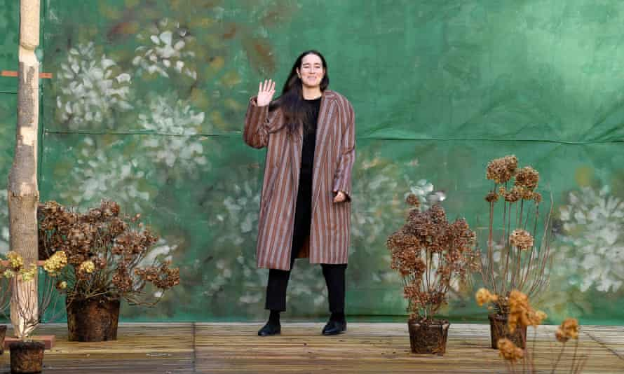 Designer Emily Bode greets the audience at the end of her Fall/Winter 2020-2021 show at Paris Fashion Week.