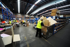 Workers pack and prepare orders at a Myer online distribution centre in Melbourne.