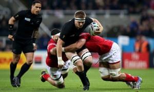 Sam Cane of the All Blacks is tackled by Halani 'Aulika and Sione Kalamafoni of Tonga.