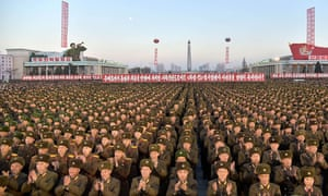 North Korean soldiers and Pyongyang residents celebrate the country's declaration it had achieved full nuclear statehood.