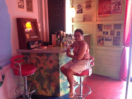 Chantawipa Apisuk, founder of Empower, sits at a museum exhibit recreating a 1970s bar where American soldiers would drink and have sex in Thailand