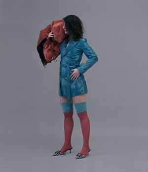 Nassia wears jacket, price on request, by Acne Studios. Gilet, £295, by Fiorucci. Shoes, £585, by Manolo Blahnik. Stockings, from a selection, by Maxine Beiny.