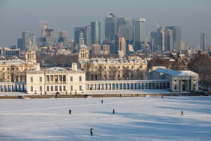 The skyscrapers of Canary Wharf are seen behind the Queen's House and the Old Royal Naval College in Greenwich, London.