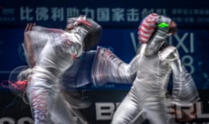 Wuhi, China. Jeon Hee-sook (L) of South Korea competes against Lee Kiefer of the US in the qualification round of the women's team foil at the Fencing World Championships