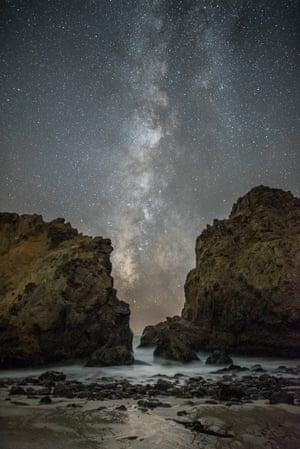 Between the Rocks Rick Whitacre (USA) Our galaxy, the Milky Way, stretches across the night sky between two of the imposing rocks at Pfeiffer State Beach, near Big Sur, California.