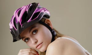 """A woman in a bra and helmet looks at the camera with the slogan """"Looks like shit. But saves my life' written over image."""