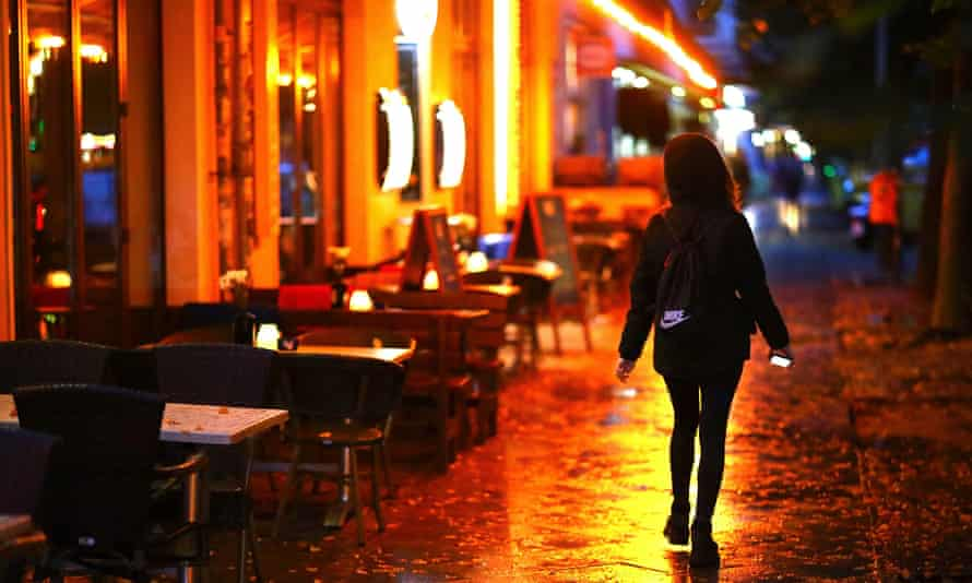A woman passes empty tables in Berlin